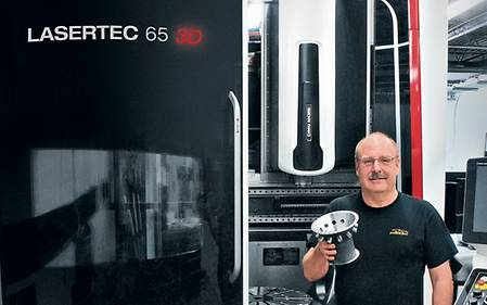 Marv Fiebig, president of PTooling, in front of his new LASERTEC 65 3D